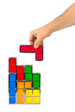 Hand with tetris toy blocks Royalty Free Stock Photo