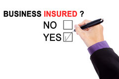 Hand with text of business insured Royalty Free Stock Photo