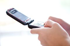 Hand texting on mobile phone Stock Images