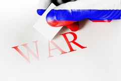 Hand textured flag eraser to erase the word war. Concept of peace. Hand textured flag eraser to erase the word war Stock Images