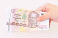Hand with Thai money Royalty Free Stock Images