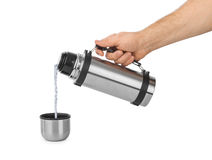 Hand and thermos flask Stock Images