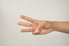 Hand with three fingers Stock Images