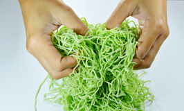 Hand thresh raw Chinese jade noodle prepare to cook Royalty Free Stock Image