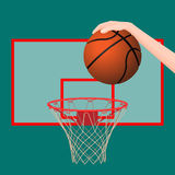 Hand throwing ball in basketball hoop colorful picture Stock Images