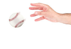 A hand throwing a baseball. Isolated Royalty Free Stock Photo
