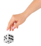 Hand throwing big dice Royalty Free Stock Photos