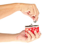 Hand throwing coin in purse Royalty Free Stock Photos