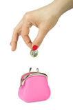Hand throwing coin in purse. On white background stock photo