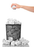Hand throwing crumpled paper into  metal basket isolated on white. Stock Photo