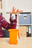 Hand throwing crumpled paper in trash Royalty Free Stock Image