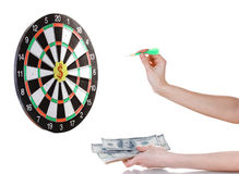 A hand throwing a dart at a sticker on darts. On white background Royalty Free Stock Photos