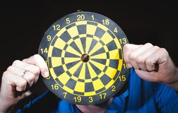 Hand throwing dart to dartboard.  royalty free stock images