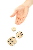 Hand throwing dice Stock Photos