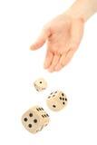 Hand throwing dice Stock Photos