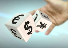 Hand throwing 2 dice with currency symbols. Concept for financia. L advice, trading, markets. Strong depth of field stock illustration