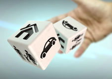 Hand throwing 2 dice with home, family and car symbols. Concept. For risking everything you own stock photos