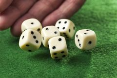 Hand throwing dices Stock Photography