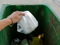 Hand throwing garbage in litter bin Royalty Free Stock Photos