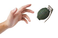 Hand throwing a green grenade on white Stock Images
