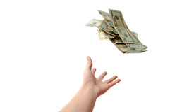 Hand throwing money Royalty Free Stock Photos