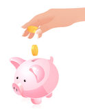 Hand throwing money in piggy bank Stock Photo