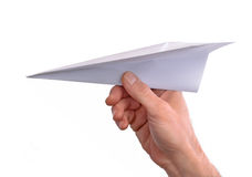 Hand throwing paper plane Stock Photography