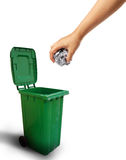 Hand throwing paper recycle into the trash. Ecology concept Royalty Free Stock Photo