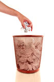 Hand throwing a paper into a wastebasket Royalty Free Stock Images