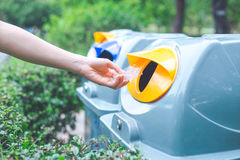 Hand throwing a plastic bag into the bin.Concepts of environment Royalty Free Stock Photography