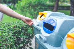 Hand throwing a plastic bag into the bin.Concepts of environment Stock Photography