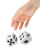 Hand throwing two dices Stock Photography