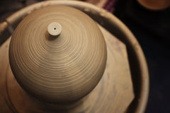 Hand thrown pot. A hand thrown pot on a pottery wheel Royalty Free Stock Photography