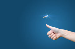 Hand throws a coin on a blue background to make the decision. Concept Royalty Free Stock Photo