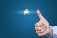 Hand throws a coin. Hand throws a coin to make the decision Royalty Free Stock Images