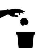 Hand throws trash Stock Image