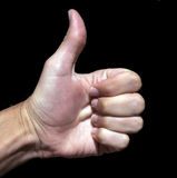 Hand With Thumb Up. Hand - Fist With Thumb Up On A Black Background Royalty Free Stock Photography