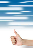 Hand thumb up on abstract media blue background. Royalty Free Stock Photography