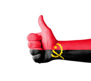 Hand with thumb up,Angola  flag painted Royalty Free Stock Photography