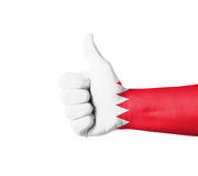 Hand with thumb up, Bahrain  flag painted Stock Photos