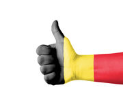 Hand with thumb up, Belgium  flag painted Royalty Free Stock Images