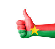 Hand with thumb up,Burkina Faso  flag painted Royalty Free Stock Photo