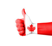 Hand with thumb up, Canada  flag painted Royalty Free Stock Image