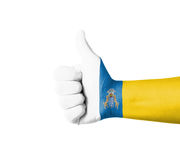 Hand with thumb up, Canary Islands  flag painted Stock Images