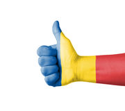 Hand with thumb up, Chad  flag painted Royalty Free Stock Photo
