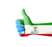Hand with thumb up, Equatorial Guinea  flag painted Royalty Free Stock Images