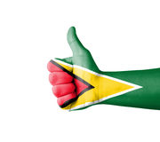 Hand with thumb up, Guyana  flag painted Stock Photo