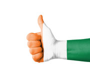 Hand with thumb up, Ivory Coast  flag painted Royalty Free Stock Image