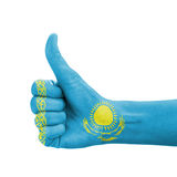 Hand with thumb up, Kazakhstan flag painted Royalty Free Stock Image