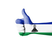 Hand with thumb up, Lesotho  flag painted Royalty Free Stock Photo